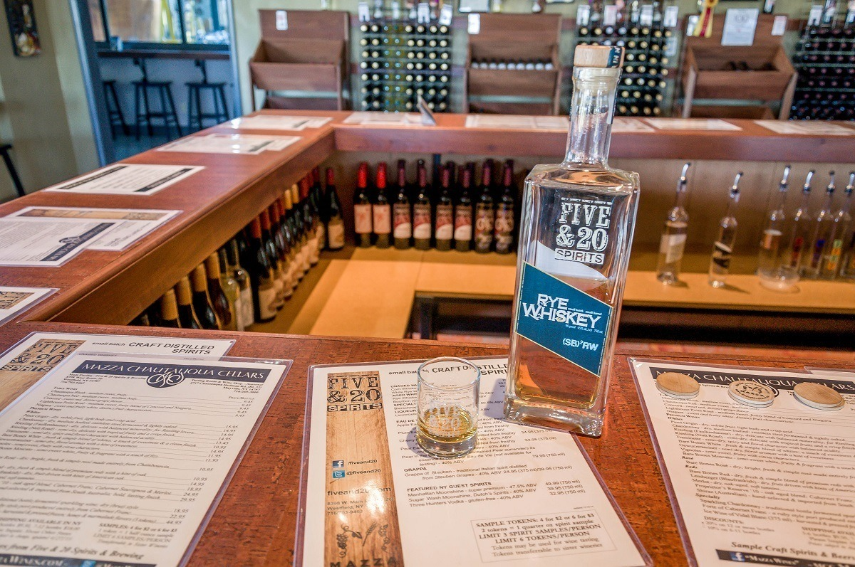 Rye whiskey on the bar with menus at Five & 20 Spirits & Brewing
