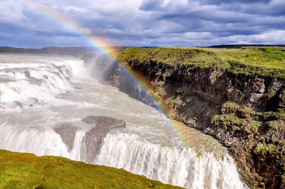 Rainbow over the Gullfoss waterfall on Golden Circle, one of the top day trips from Reykjavik.