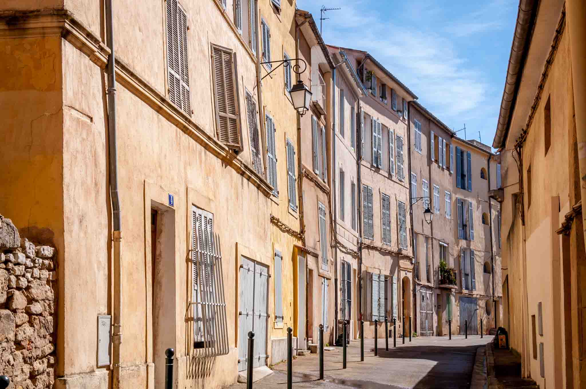Peach and yellow buildings along a street in Aix-en-Provence France
