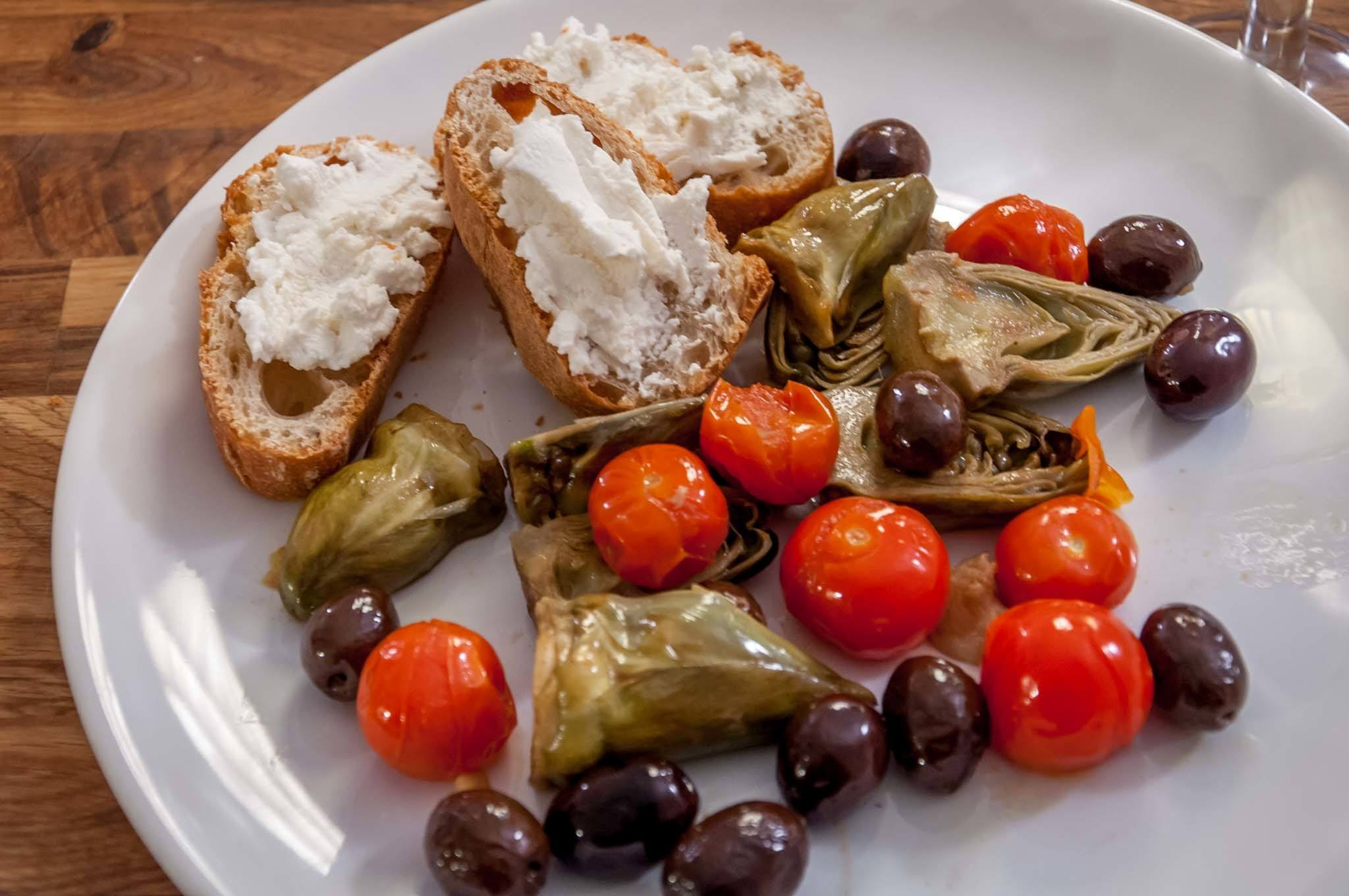 Artichokes, olives, tomatoes, and French bread