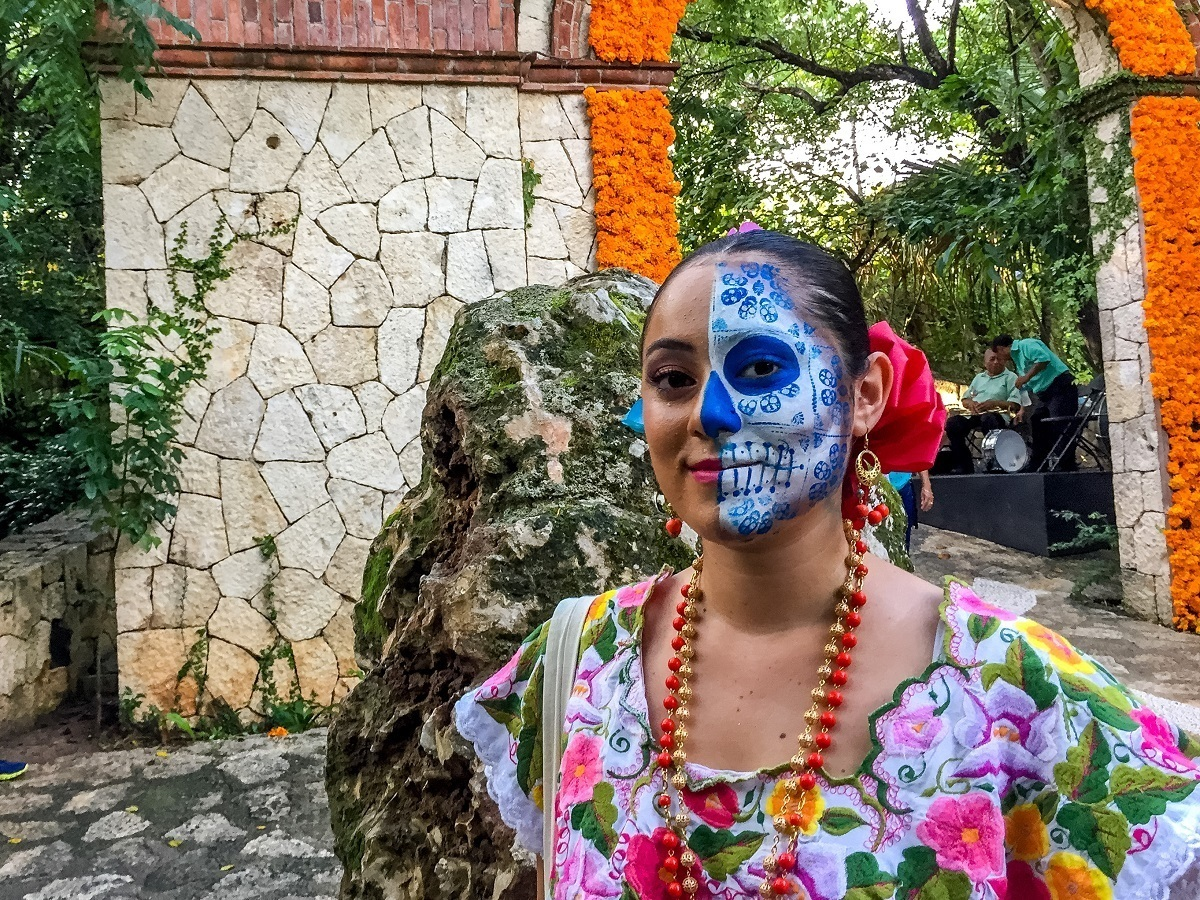 Woman wearing skeleton face paint for Day of the Dead