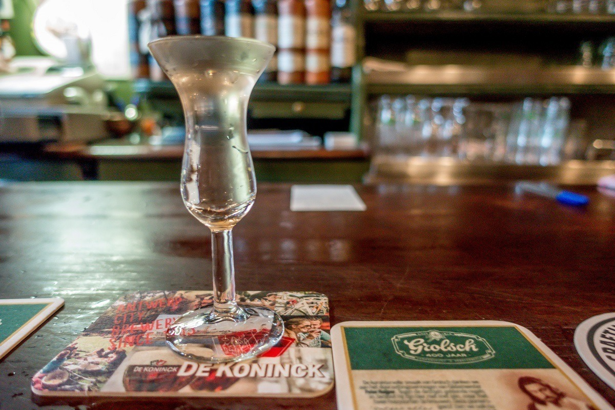 A glass filled to the brim with genever at De Drie Fleschjes, a tasting room in Amsterdam