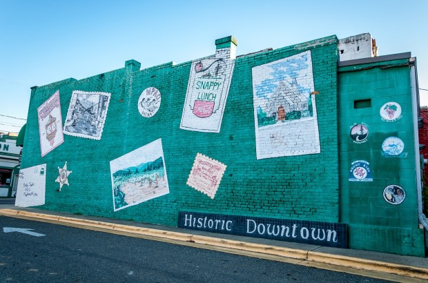 "A painted wall in downtown shows features of the area. From outdoor activities to wine tasting to taking in the sights of ""Mayberry,"" there are so many fun things to do in Mount Airy NC"