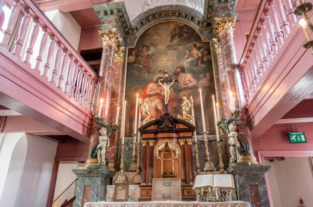 The unusual sanctuary and altar of Our Lord in the Attic in Amsterdam, Netherlands. This unique place was a clandestine church for several hundred years when Catholics were not allowed to practice their religion openly in the country.