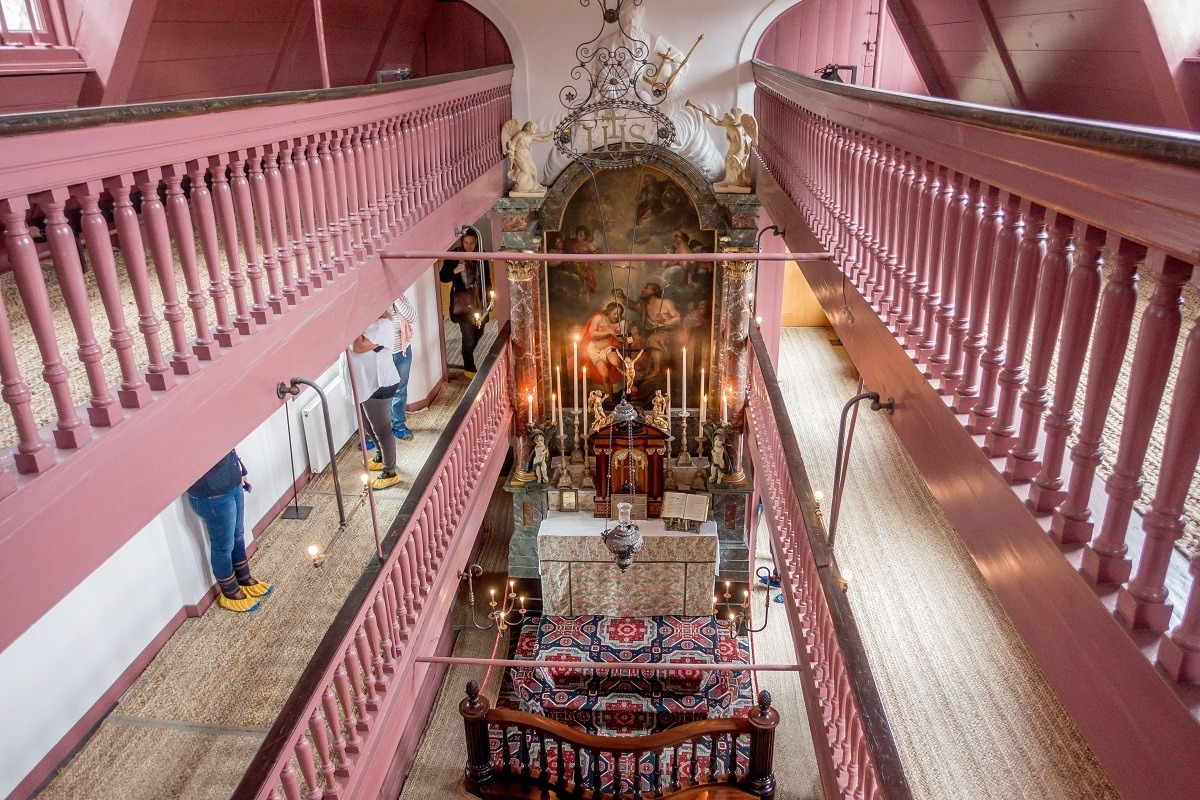 Pink railings above the altar at Our Lord in the Attic, a clandestine church in Amsterdam