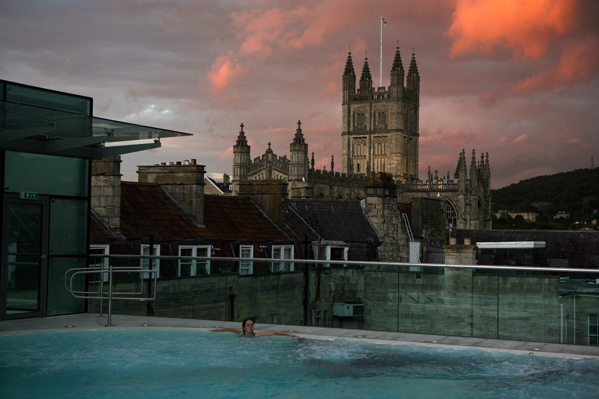 The Bath Abbey Cathedral from the Open-air Rooftop Pool at the Thermae Spa in Bath, England.