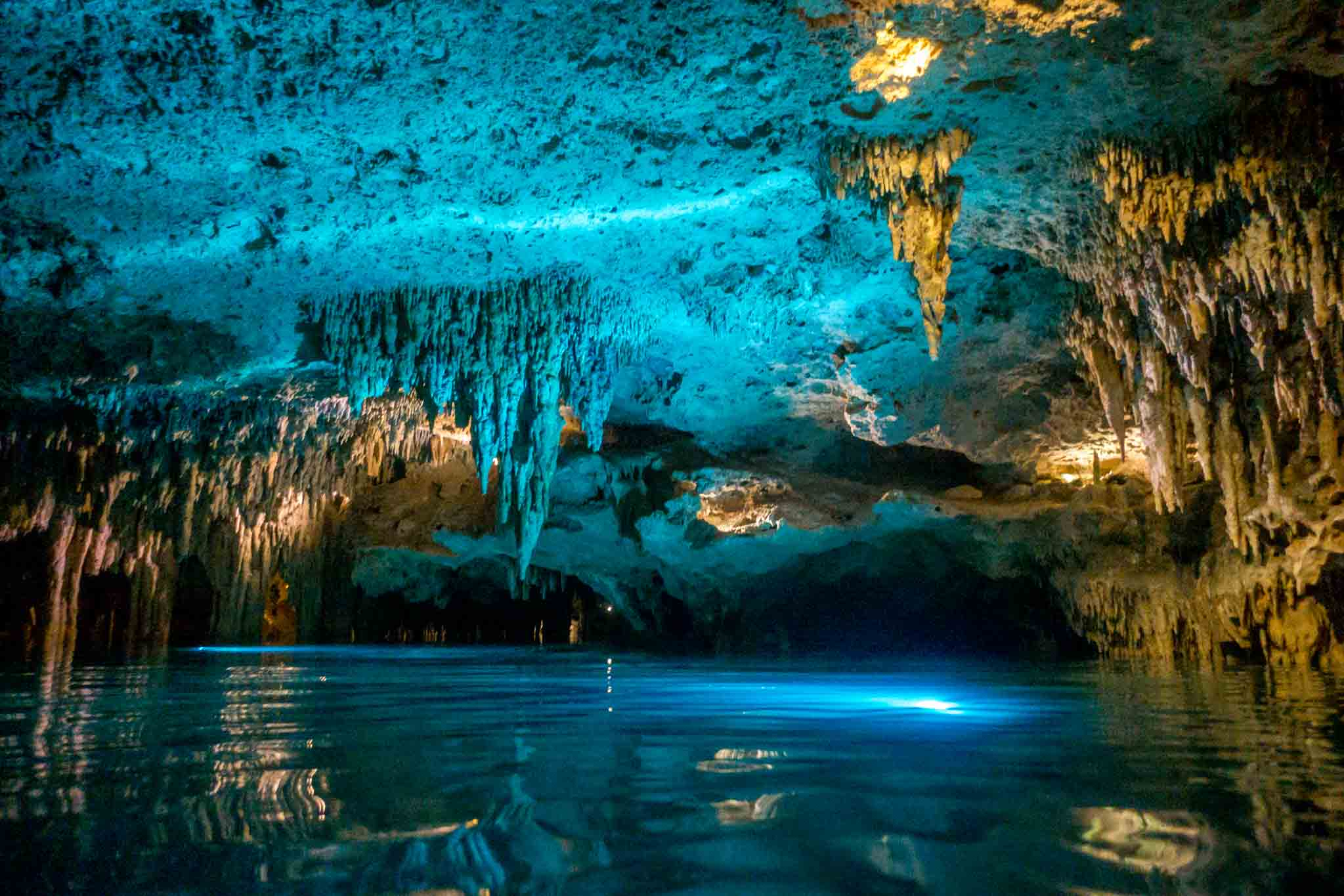 Underground river lit up with blue light
