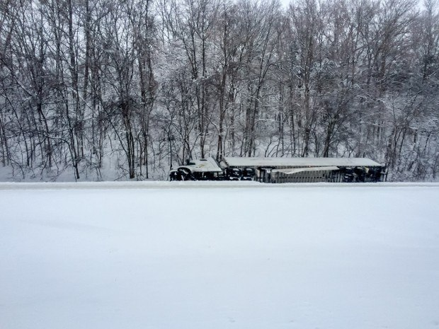 18-wheeler that slid off the road in a snowstorm