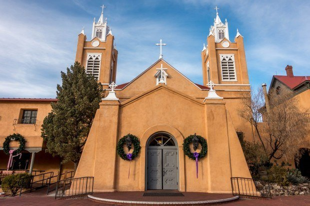 One of the top things to do in Albuquerque is to explore the Old Town art galleries and San Felipe de Neri church.