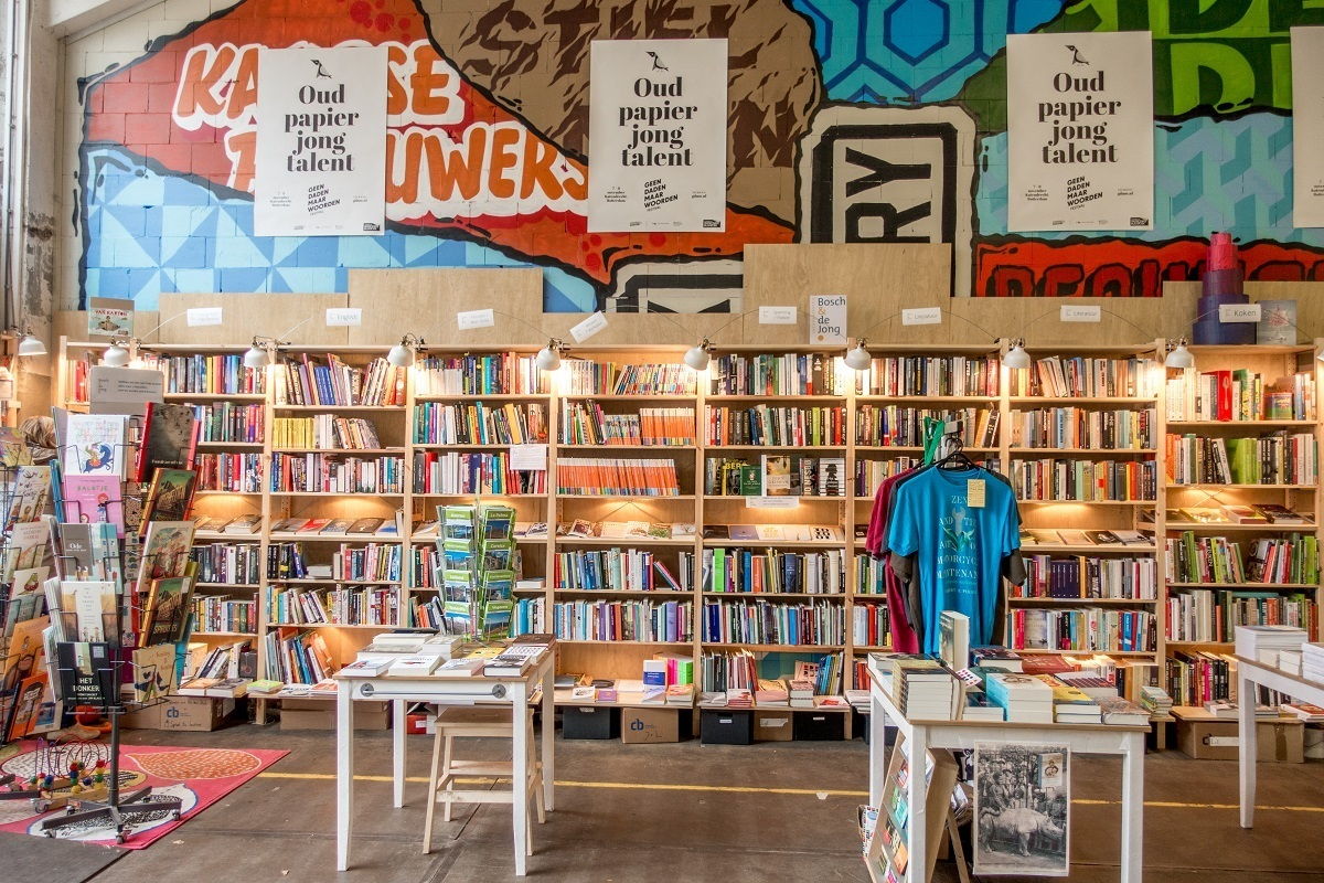 Shelves and tables full of books