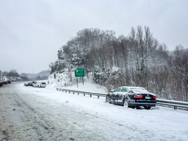 Cars spun out and abandoned in the snow