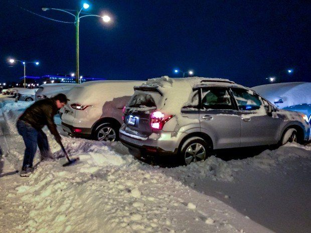 Digging out a car after a blizzard