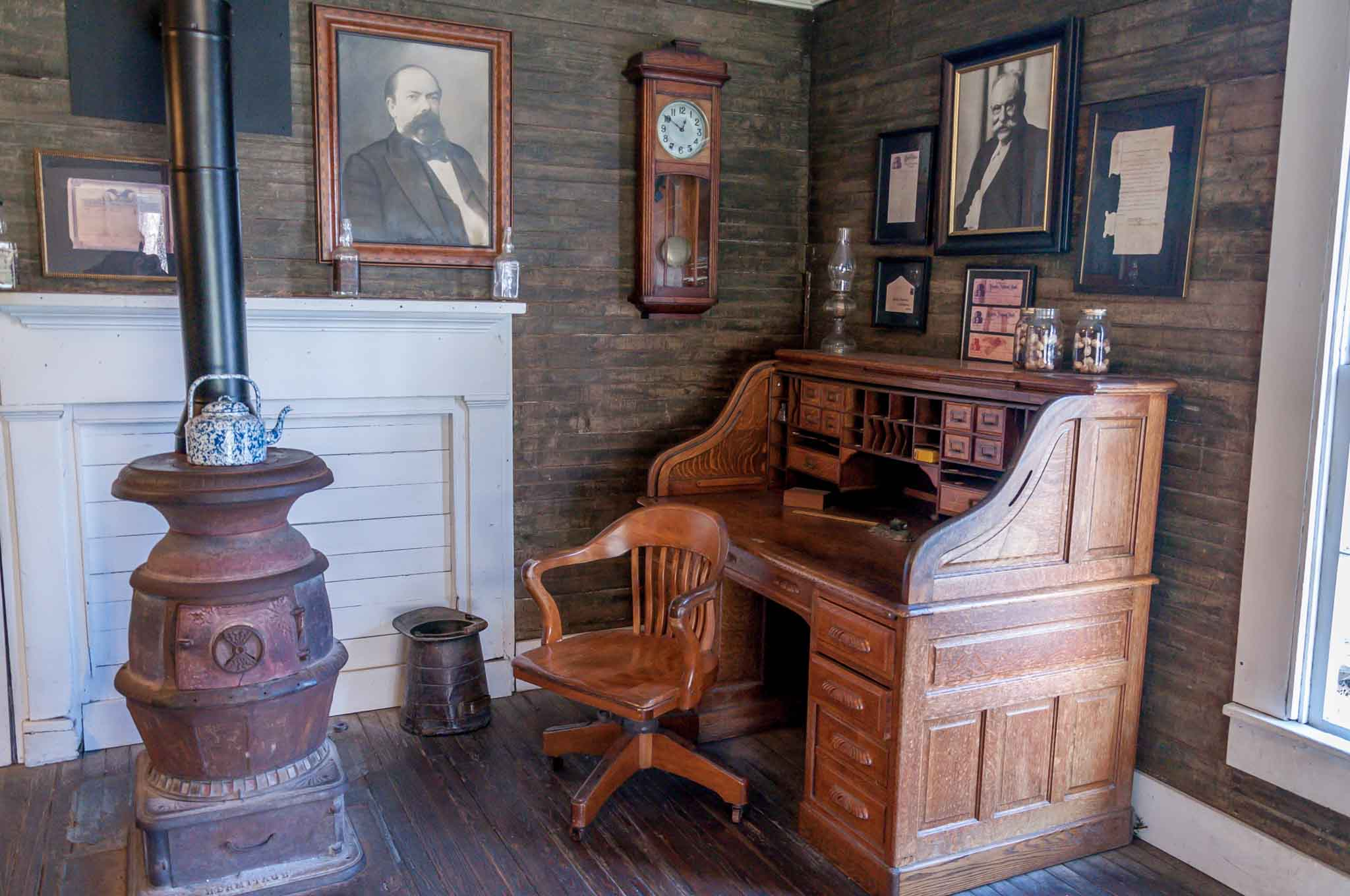 Jack Daniel's office with desk, heater, and photographs