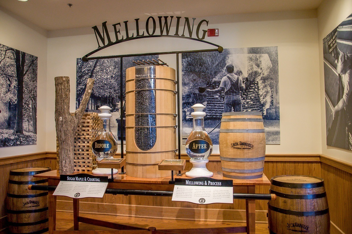 Exhibit in the Jack Daniel's distillery visitor center showing the charcoal filtration process for the whiskey