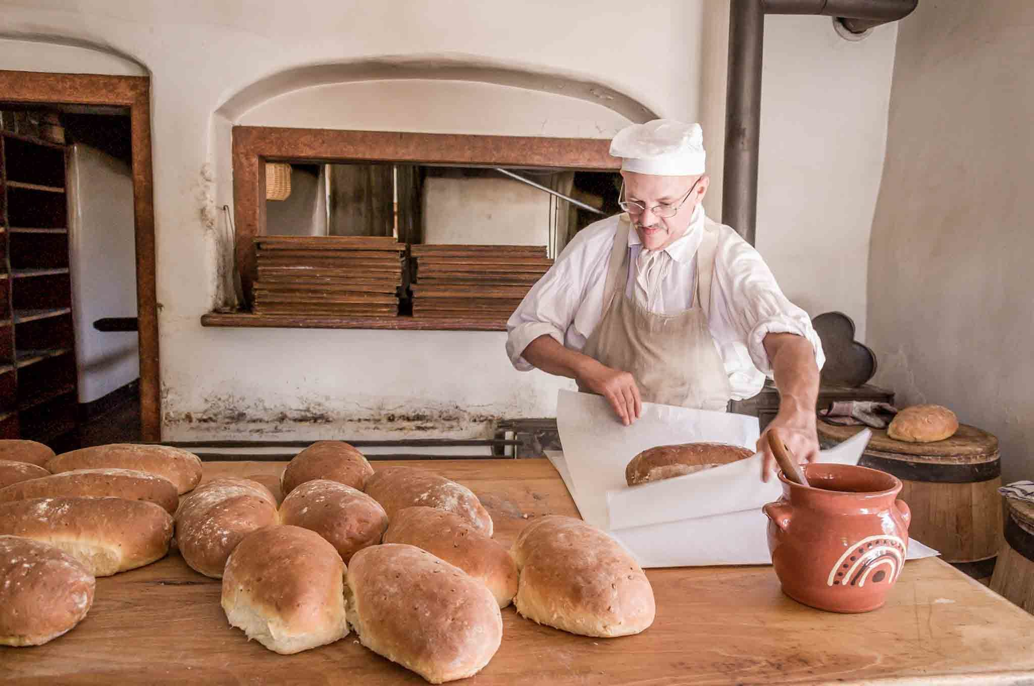 Baker making onion bread loaves at Old Salem bakery in North Carolina