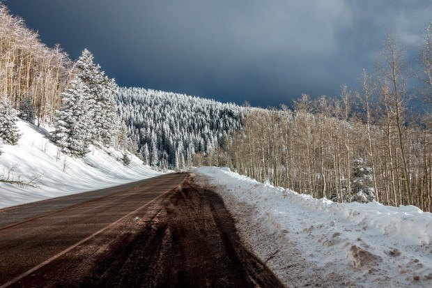 The drive through the Santa Fe National Forest with with fresh snow on the trees.