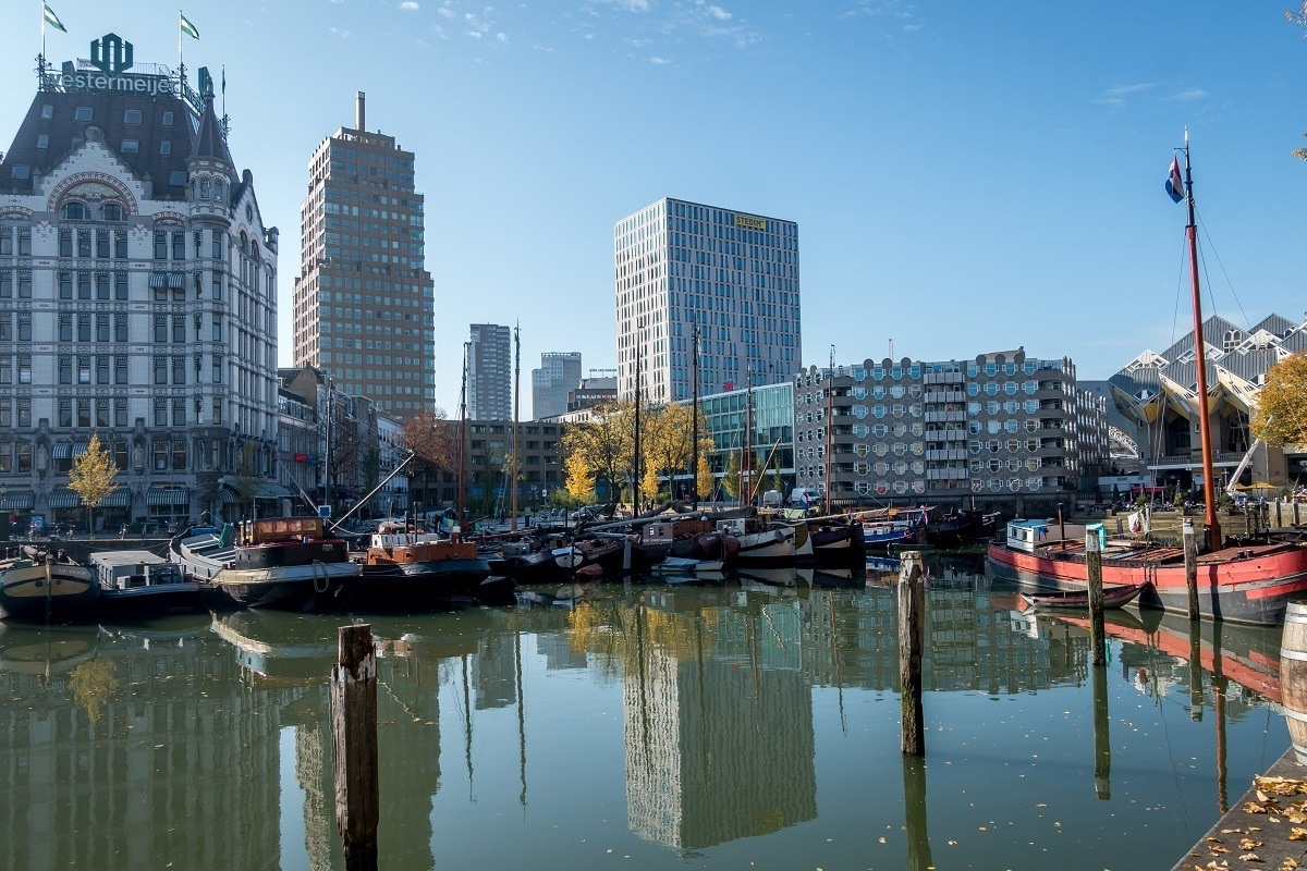 Rotterdam's Old Harbor with old boats and new buildings in old town Rotterdam Netherlands