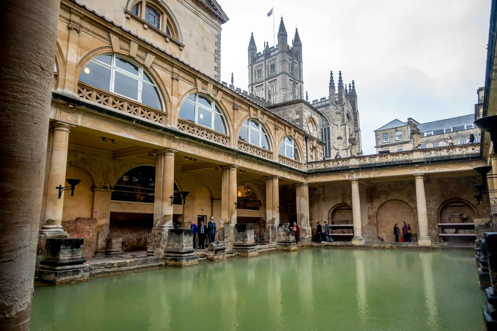 Outdoor hot springs pool known as the Great Bath surrounded by Victorian statues