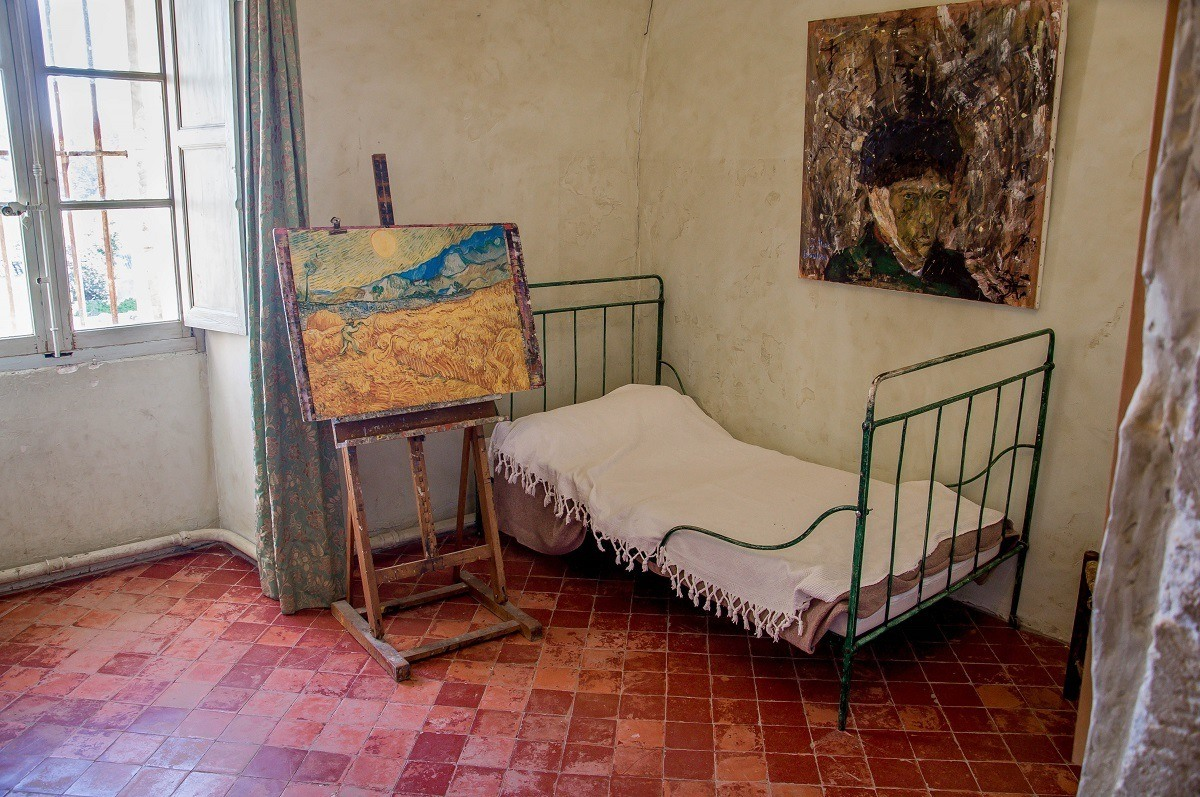 Bed and paintings in Van Gogh's room at the asylum in Saint Remy, France