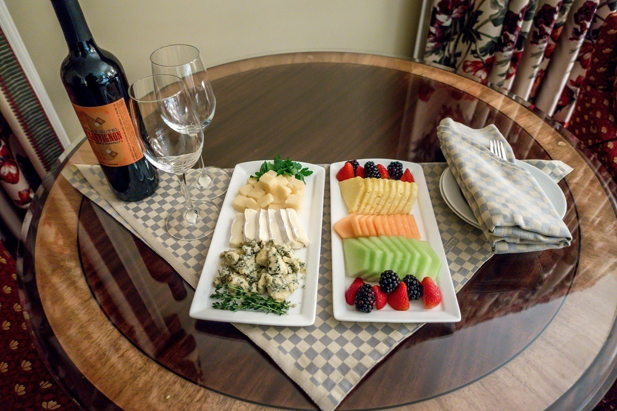 An in-room welcome gift of wine, cheese and fruit at the Hermitage Hotel.