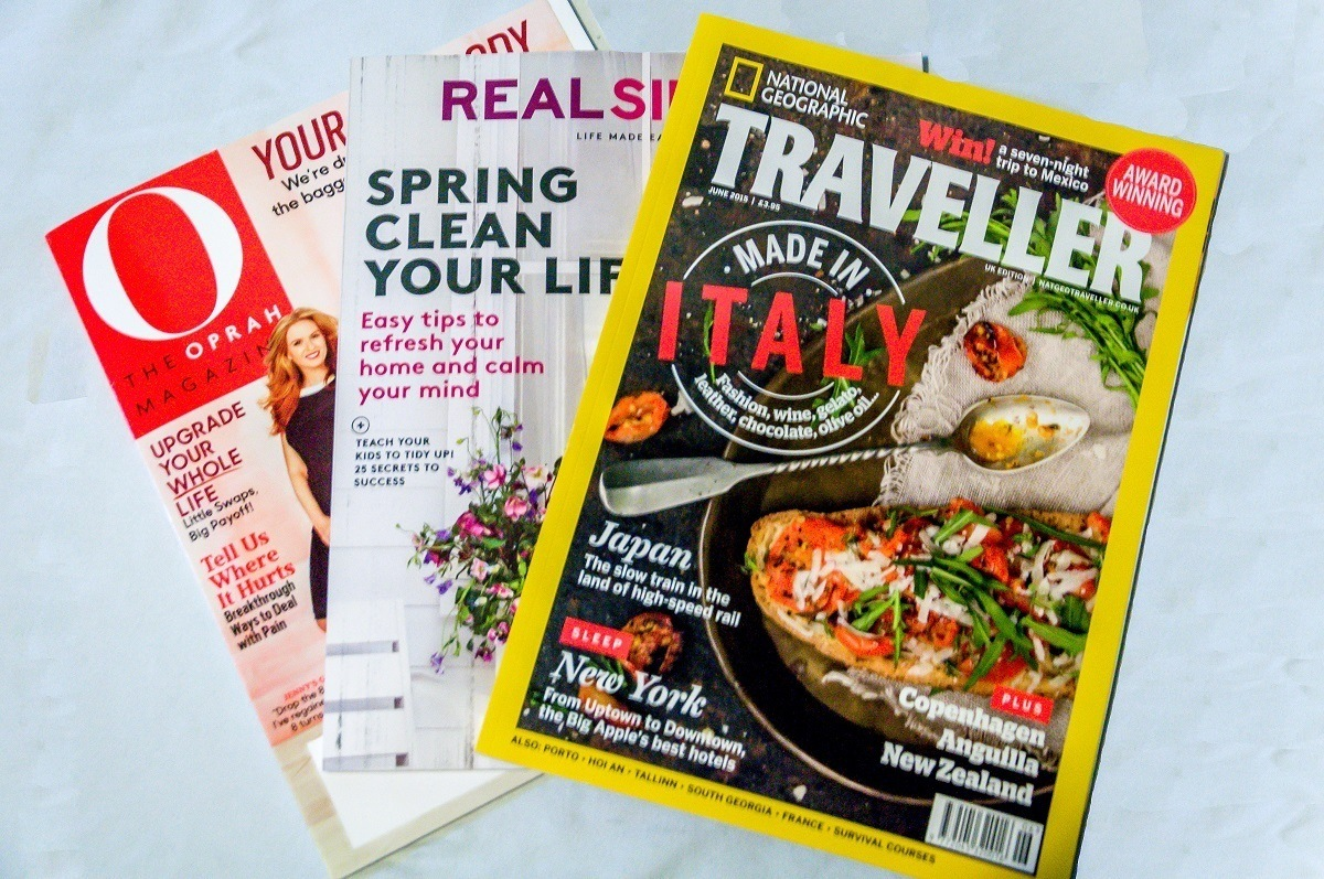 Even in the age of tablets and e-readers, magazines qualify as carry on essentials for us