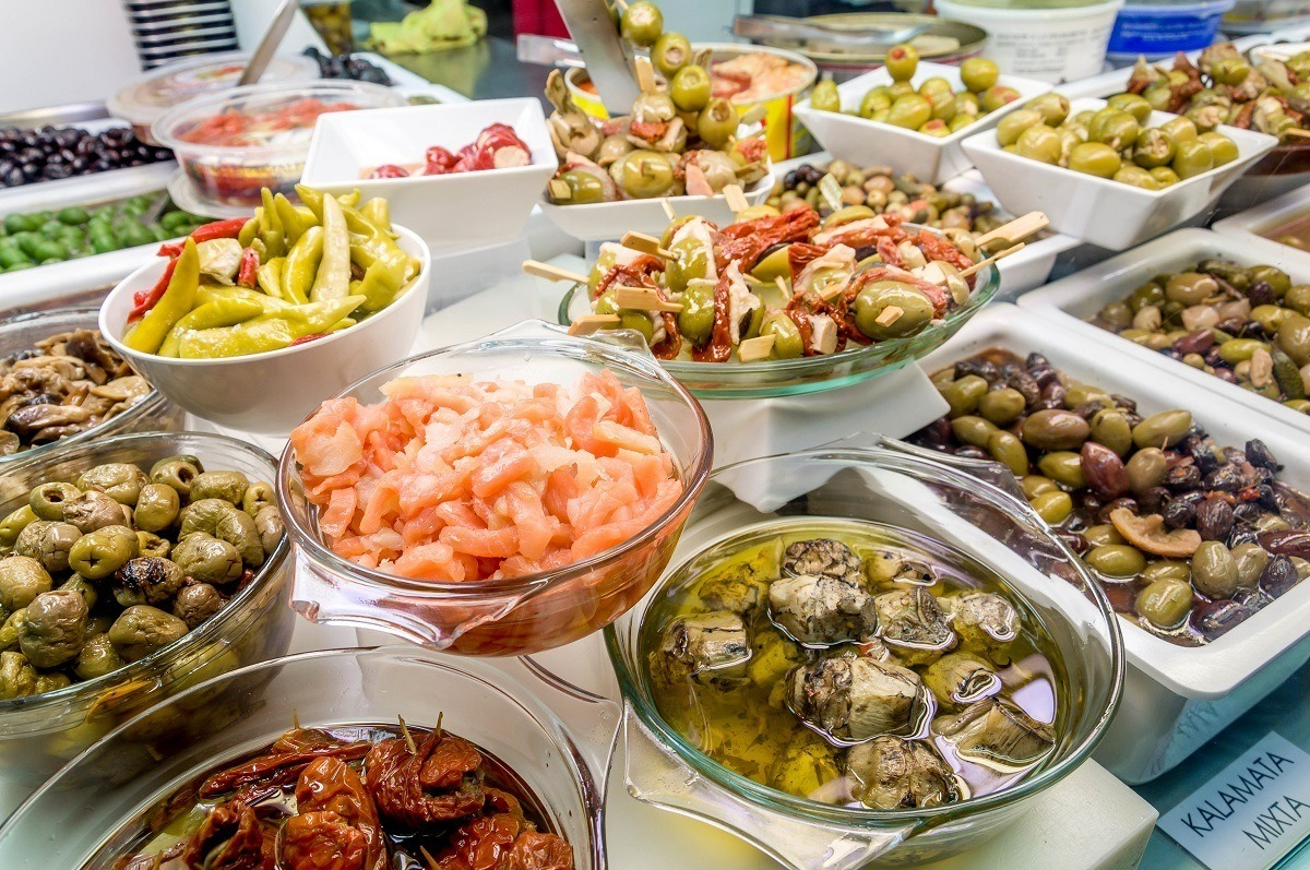 Olives and pickles at the Abaceria Central market in Barcelona, Spain