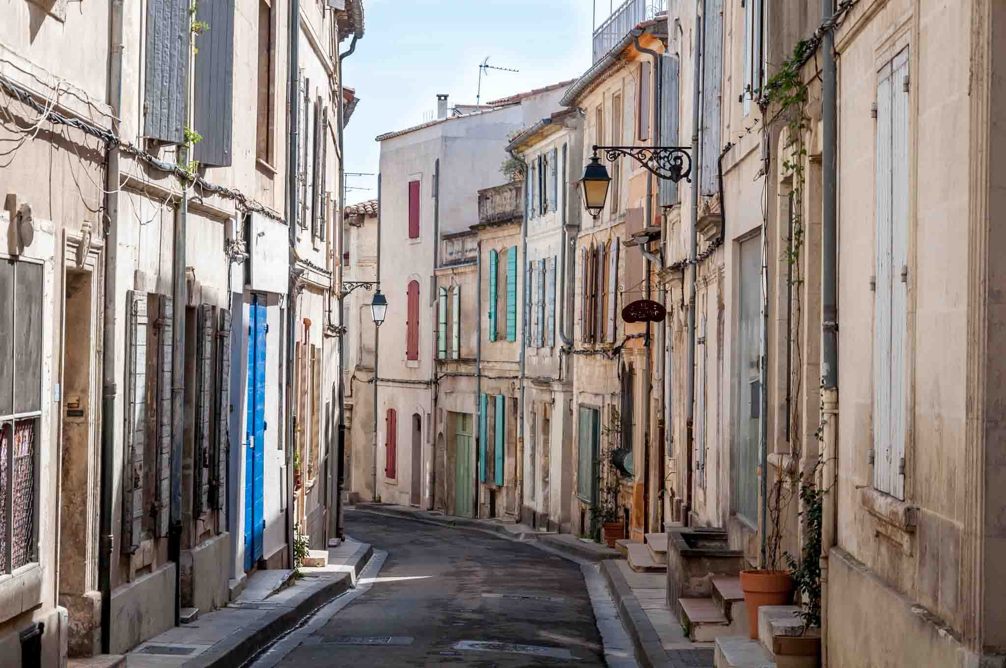 Homes with colorful shutters on a street in Arles, France