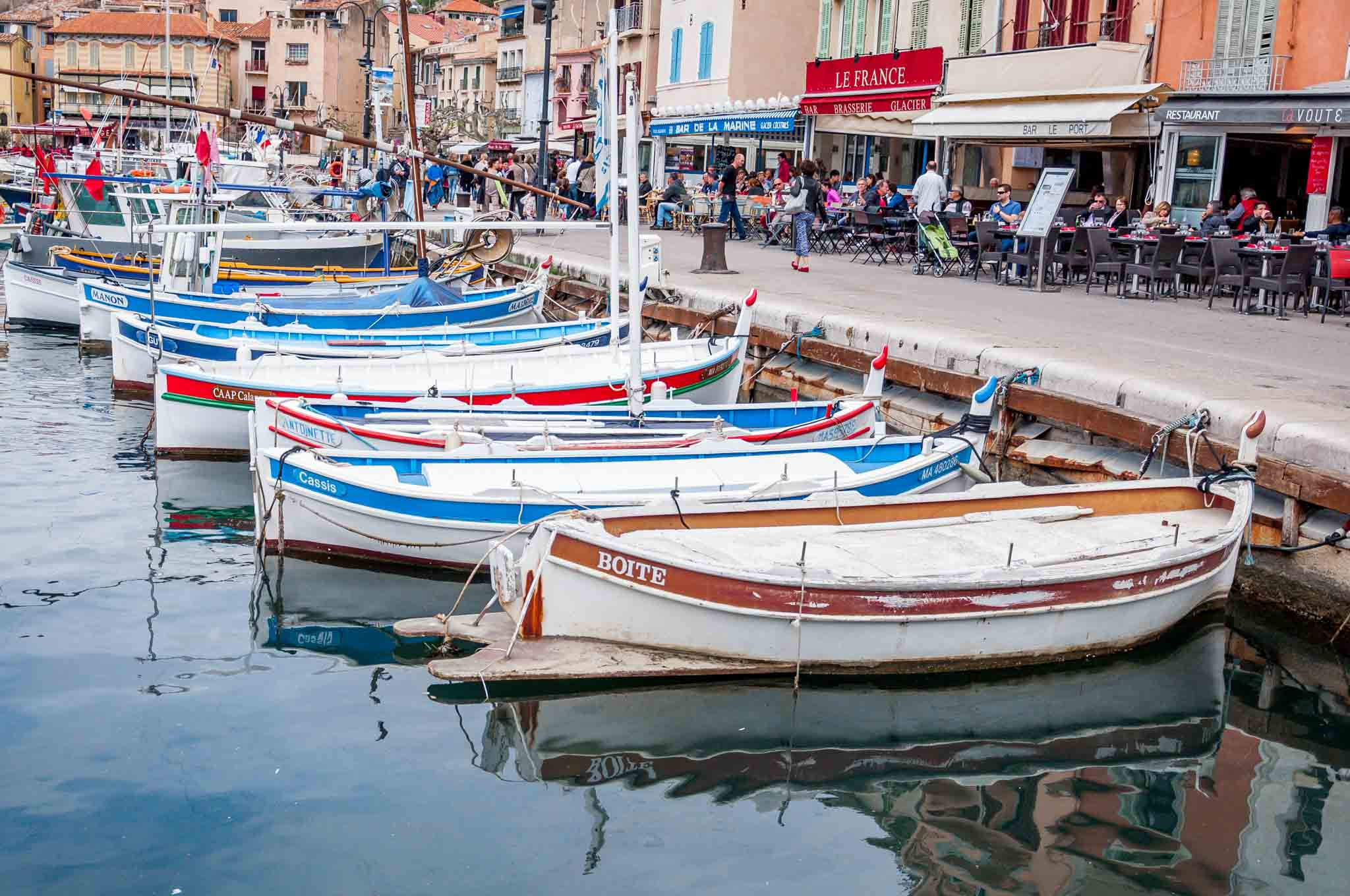 Boats and harborside restaurants in Cassis, France -- one of our favorite stops on our 10-day South of France itinerary