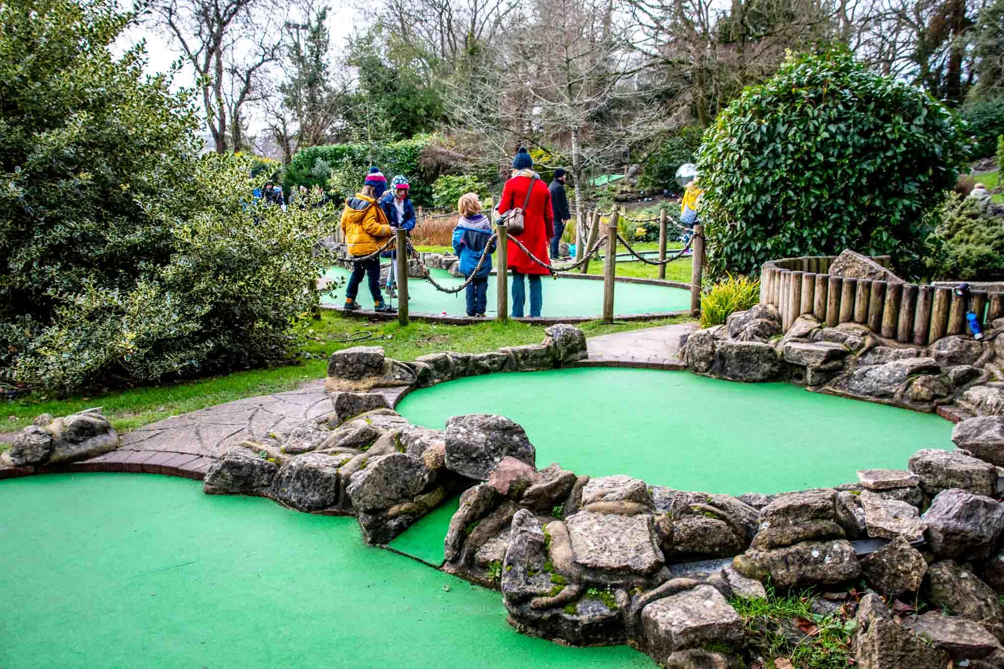 People playing mini golf at Victoria Falls Adventure Golf.