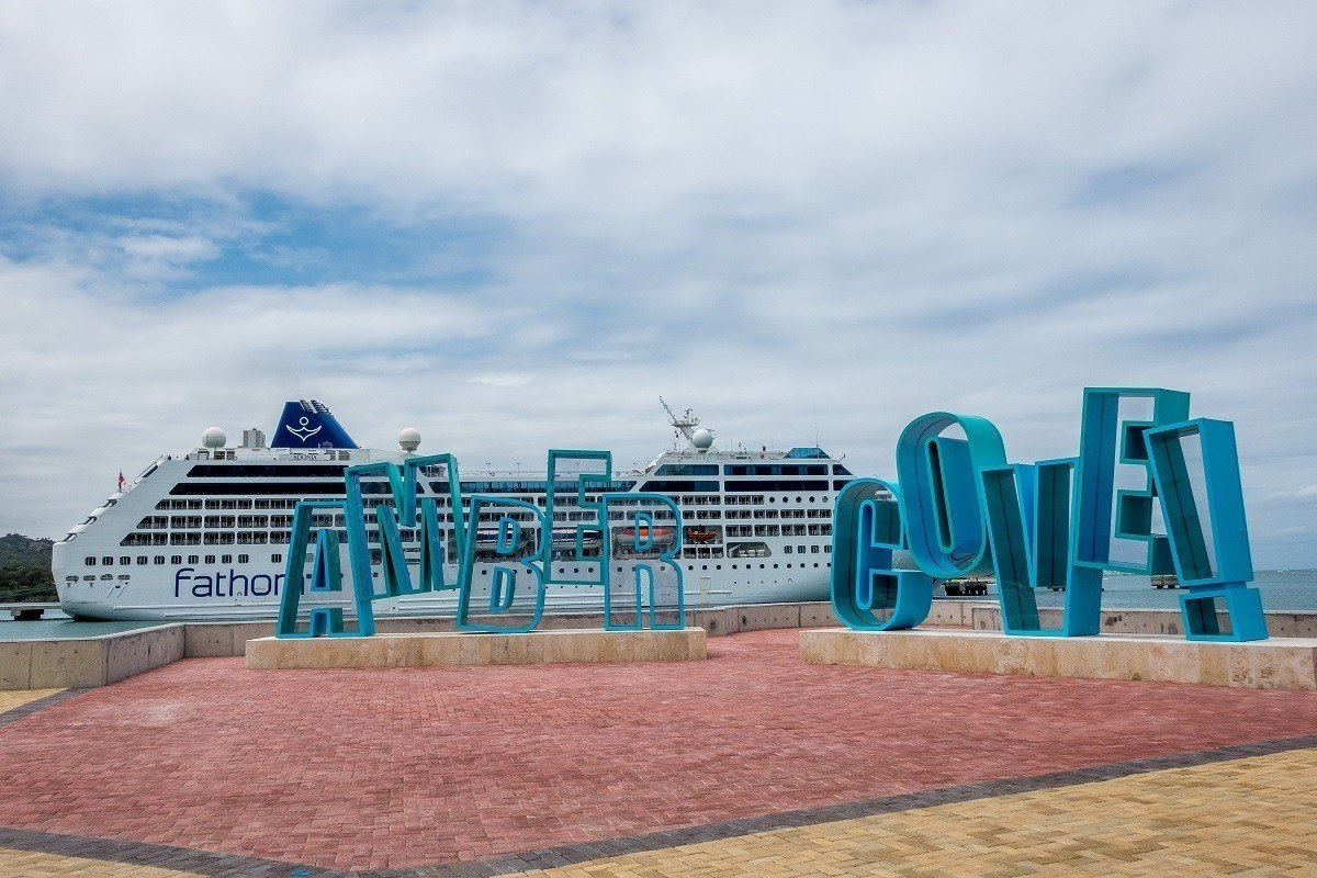 Amber Cove sign in front of cruise ship