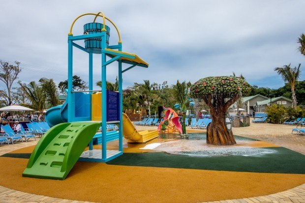 Enjoying the children's play area by the pool is one of the fun things to do in Amber Cove