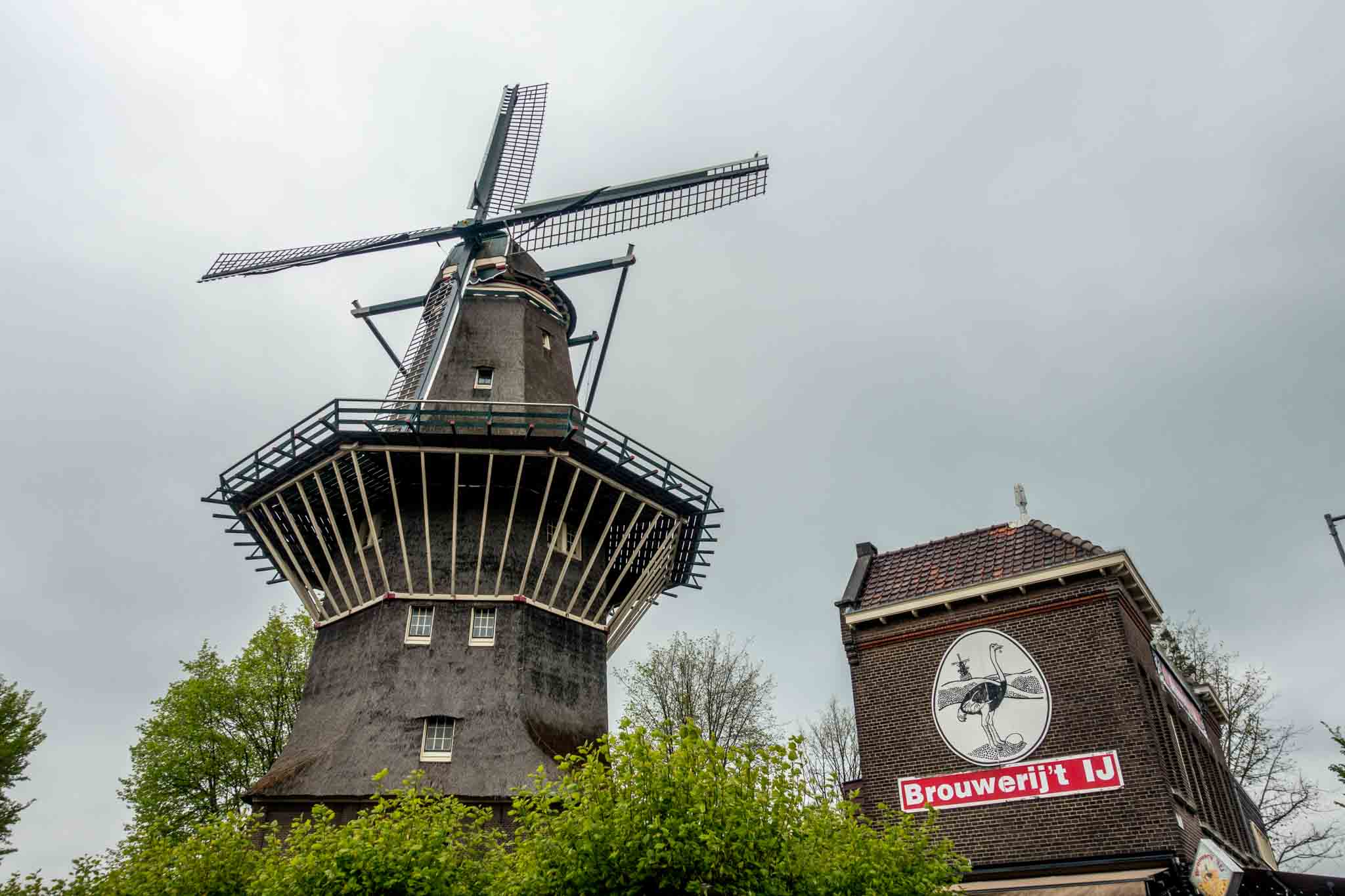 Windmill next to sign for Brouwerij 't IJ