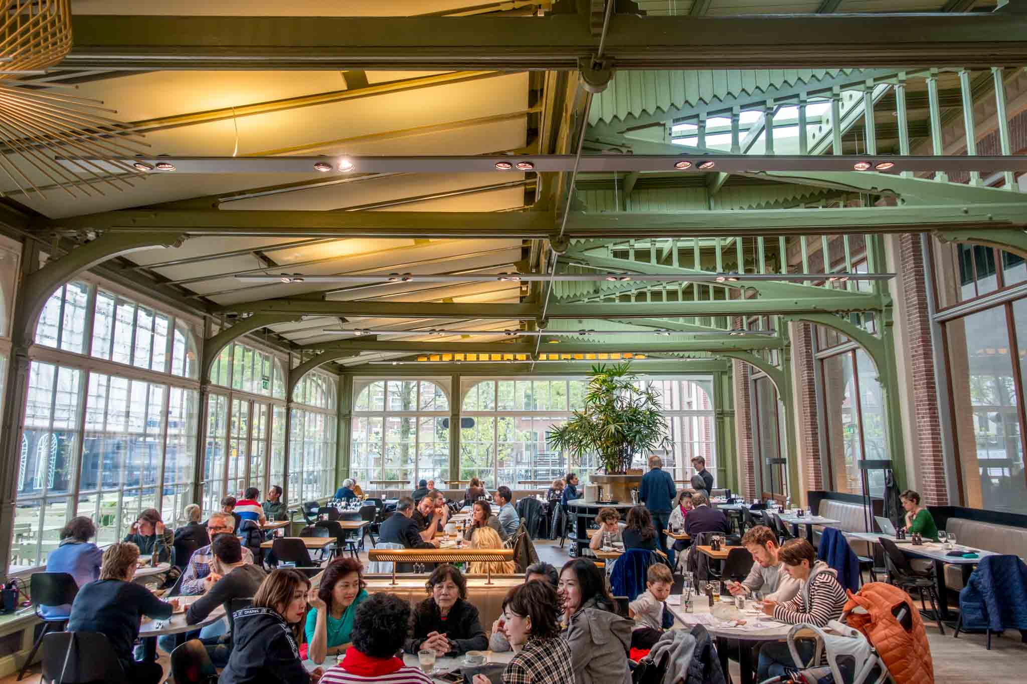 The De Plantage restaurant feels like you're eating in the middle of a garden conservatory