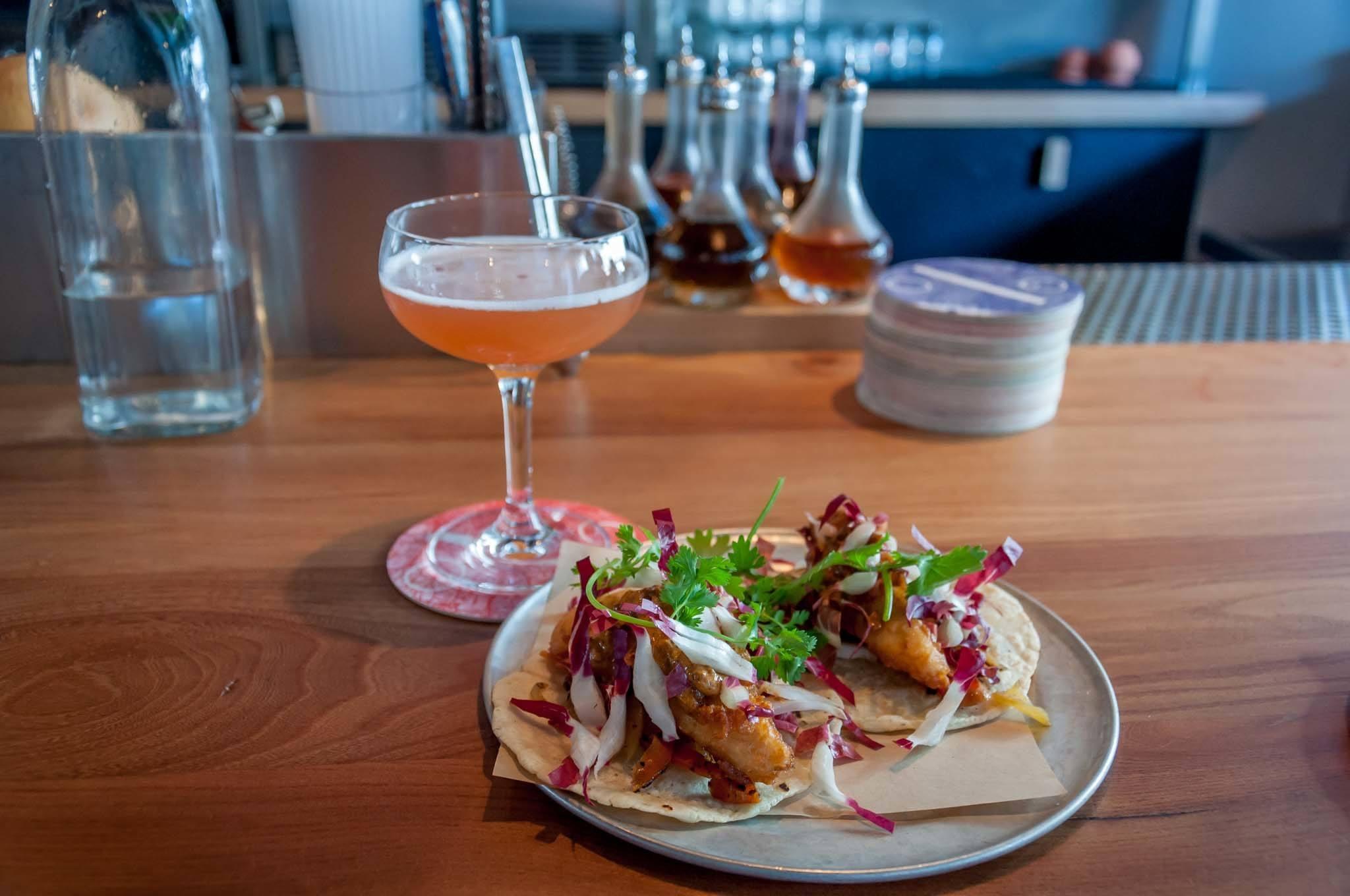 Cocktail and fish tacos at ABV