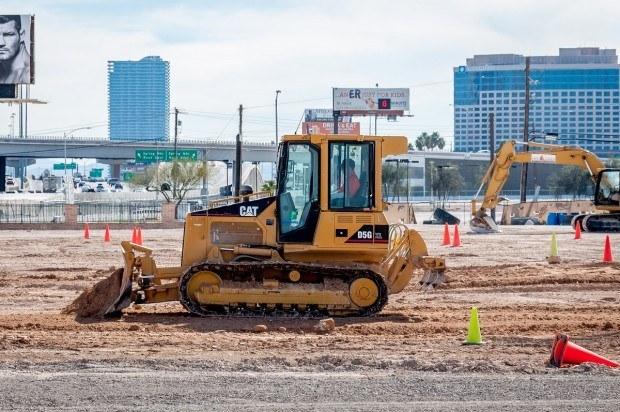 Driving a bulldozer at Dig This Las Vegas.