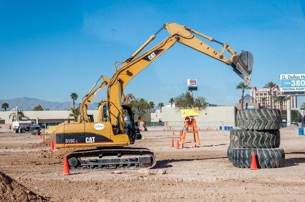 Excavator picking up tires at Dig This! Las Vegas.