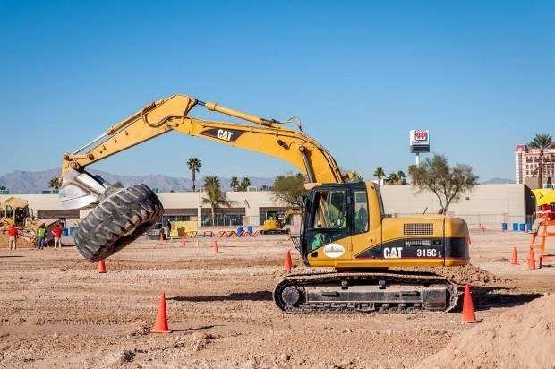 Carrying tires across the sandbox at the Las Vegas construction playground.