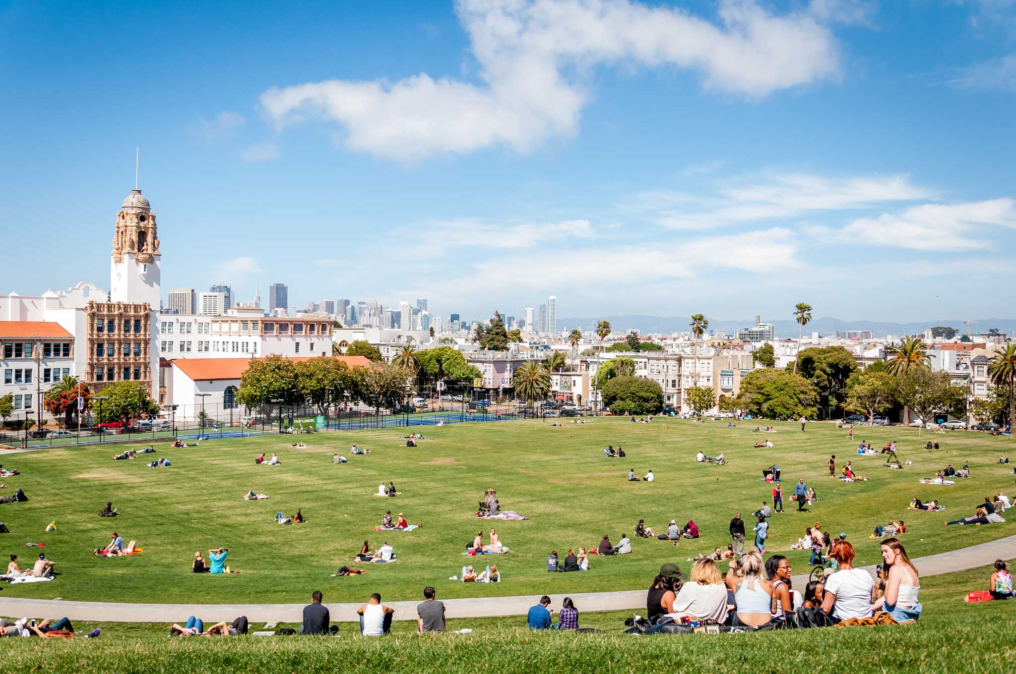People in San Francisco's Mission Dolores Park overlooking the city