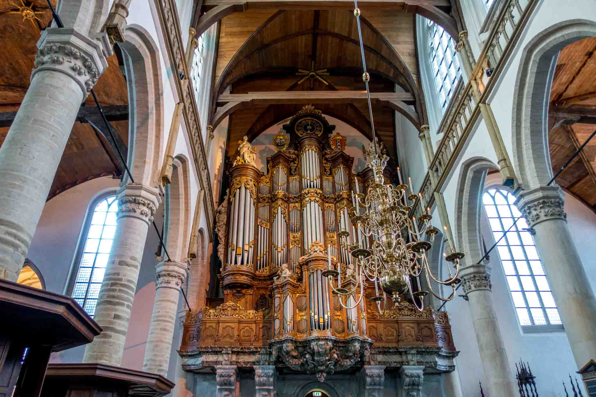 Large pipe organ decorated with statues and wood carvings