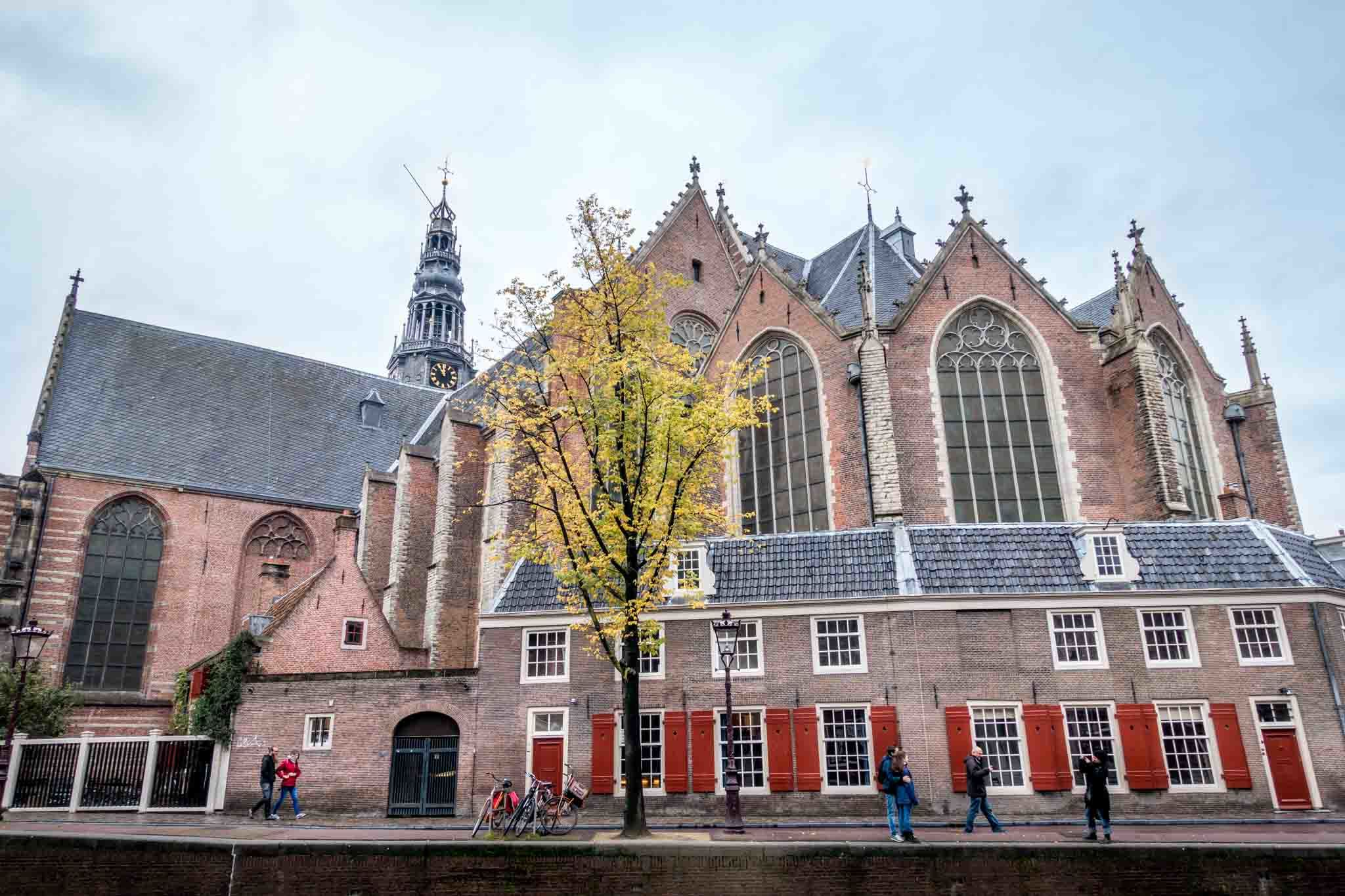 Exterior brick Oude Kerk church with stained glass and steeple