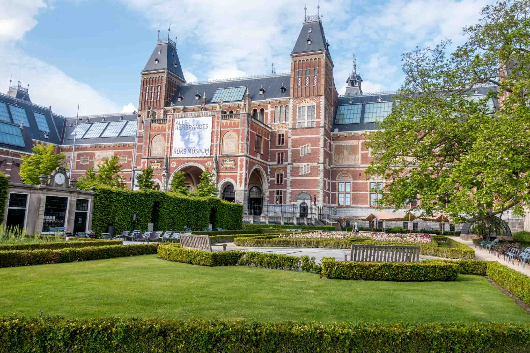 Large brick building with gardens in Amsterdam, the Rijksmuseum