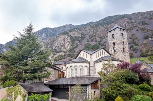 The church in Andorra la Vella with the Pyrenees Mountains towering above.