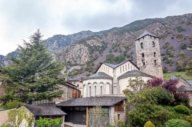 The church in Andorra la Vella with the Pyrenees Mountains towering above