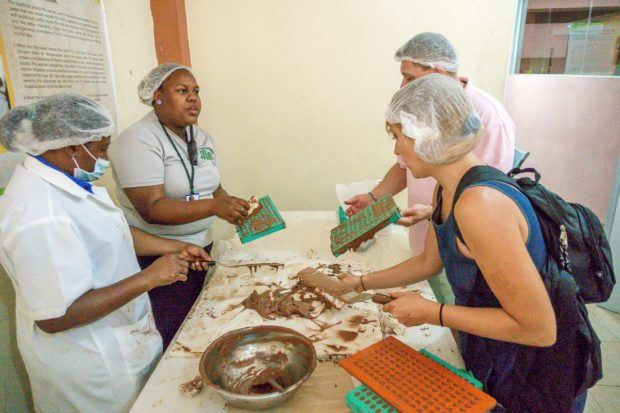 Making chocolate at Chocal is one of the activities available on a Fathom cruise to the Dominican Republic