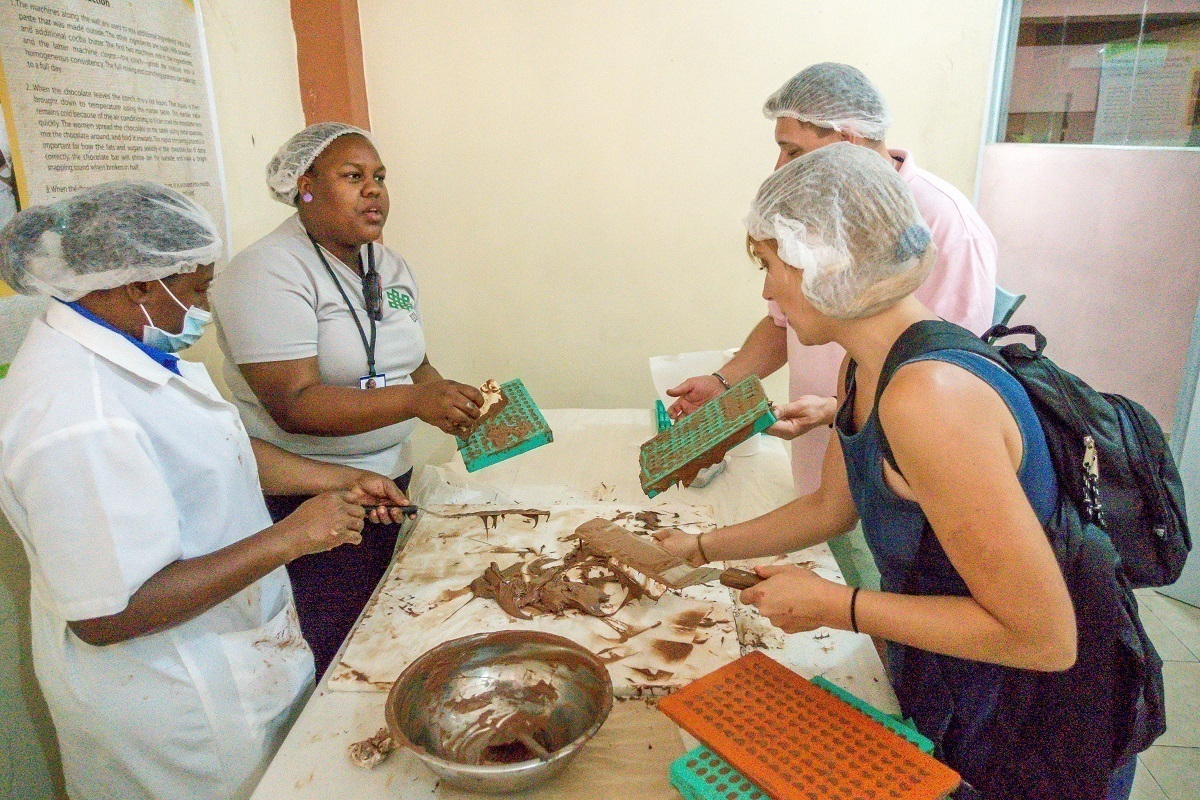 People making chocolate in molds at Chocal