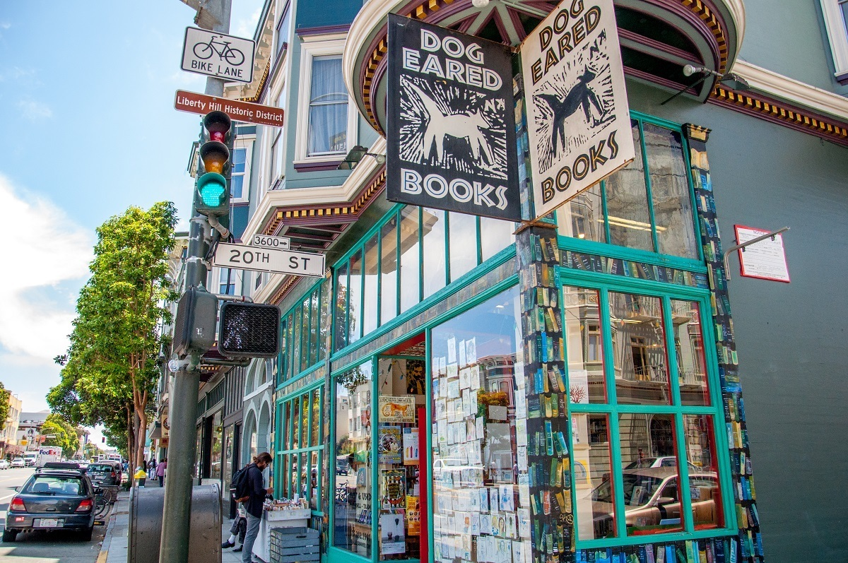 Exterior of Dog Eared Books bookstore with signage