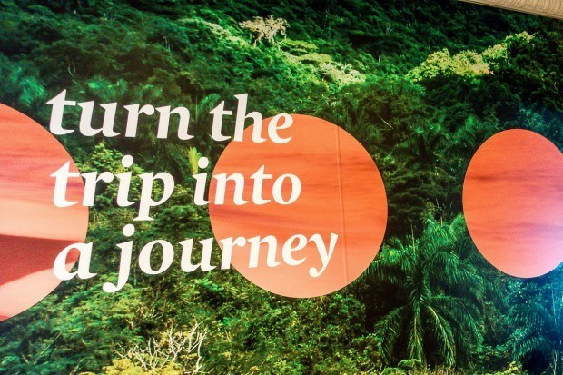 """turn the trip into a journey"" -- a poster reminder on Fathom cruise line's Adonia ship"