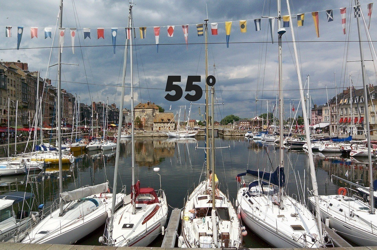"""55 degrees"" superimposed over boats in a harbor"