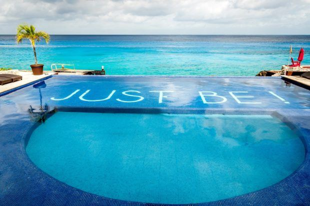 "The motto on the bottom of the Hotel B Cozumel pool is ""Just Be!"""