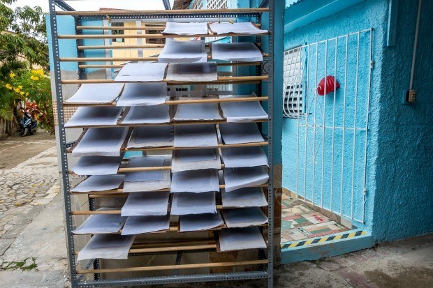 Recycled paper drying on racks in the Dominican Republic